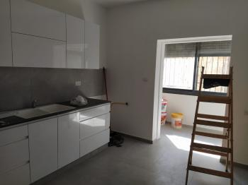 a 1 bdr garden apartment  totally renovated can be furnished