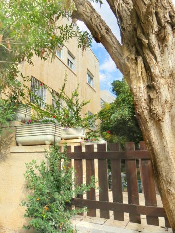 a lovely 230 sqm cottage with garden in the heart of old Katamon, quiet street.