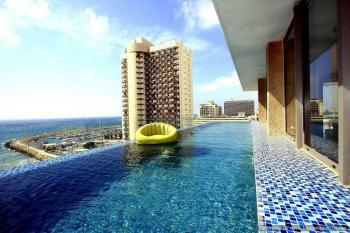 Beach front sky-pool penthouse