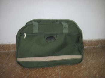 FOR SALE: 2 matching green canvas carry-on bags