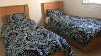 2 single beds - wood, with argaz MUST GO!!