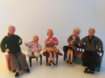 Antique dollhouse dolls