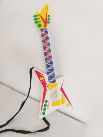 Toy guitar with sound