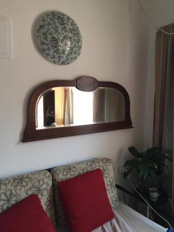 2 antique, beveled, wood-framed mirrors for sale