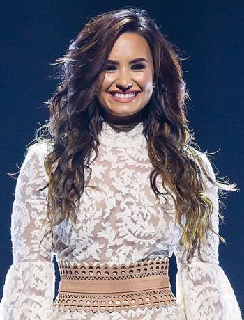 Pop star Demi Lovato meets with Shalva band in Jerusalem