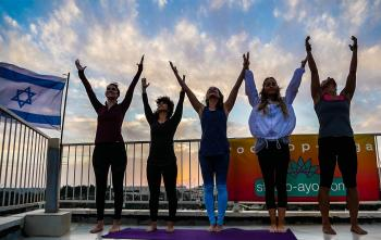 Friday Morning Rooftop Yoga!