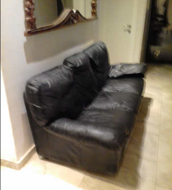 Real leather couch, 3 seater- price negotiable